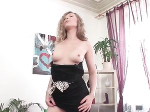 Stretching Her Shaved Pussy With A Huge Dildo